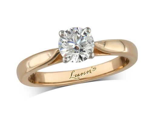 18 carat yellow gold single stone diamond engagement ring, with a certificated brilliant cut, in a four claw setting.