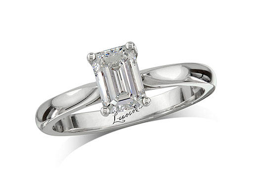 Platinum set single stone diamond engagement ring, with a certificated emerald cut, in a four claw setting.