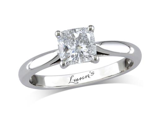 Platinum set single stone diamond engagement ring, with a certificated cushion cut, in a four claw setting.