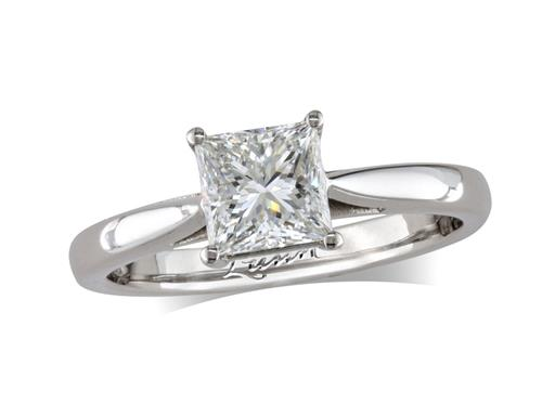 Platinum single stone diamond engagement ring, with a certificated princess cut, in a four claw setting.
