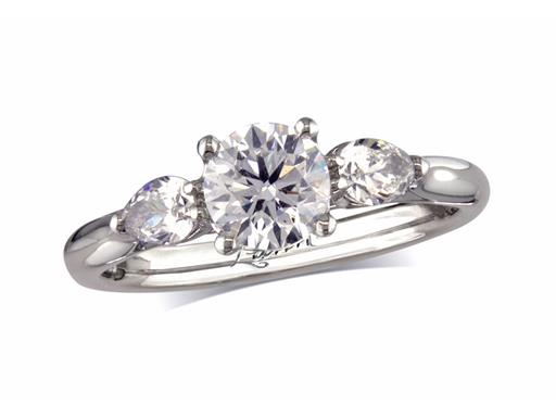 Platinum single stone diamond engagement ring, with a certificated brilliant cut centre in a four claw setting, and one pear cut on each shoulder. Perfect fit with a wedding ring. Total diamond weight: 1.26ct