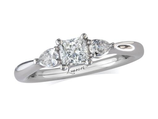 Platinum three stone diamond engagement ring, with a certificated princess cut centre in a four claw setting, and one pear cut on each shoulder. Perfect fit with a wedding ring. Total diamond weight: 0.54ct.