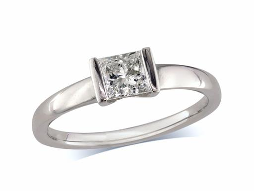Pre-owned platinum set single stone diamond ring, with a certificated princess cut diamond in a tension setting.