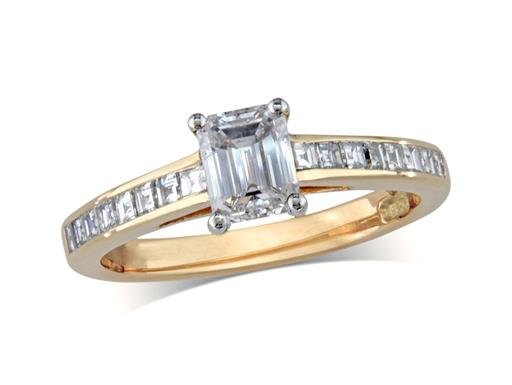 Pre-owned 18 carat yellow gold set single stone diamond engagement ring, with a certificated emerald cut centre in a four claw setting, and diamond channel set shoulders. Total diamond weight: 1.04ct.