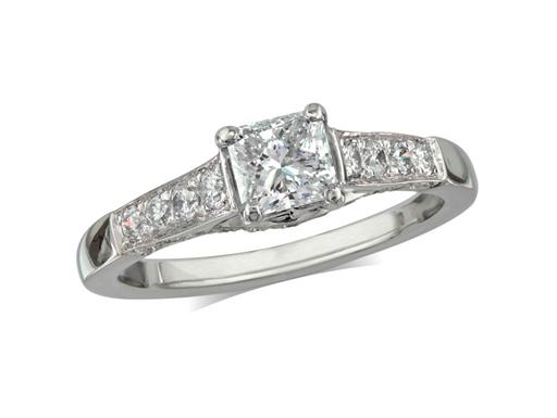 Pre-owned platinum set single stone diamond engagement ring, with a certificated radiant cut centre in a four claw setting, and diamond set shoulders. Total diamond weight: 1.00ct.