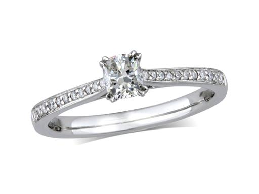 Pre-owned platinum set single stone diamond engagement ring, with a certificated cushion cut centre in a split four claw setting, and diamond set shoulders.