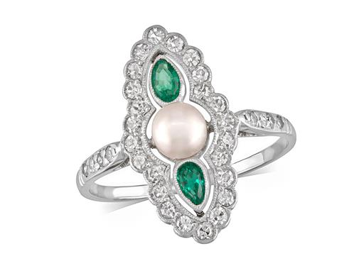 Pre-owned Emerald and Diamond Art Deco Ring. This beautiful platinum ring is set with vivid green emeralds, a natural pearl in the centre and twinkling old cut white diamonds.