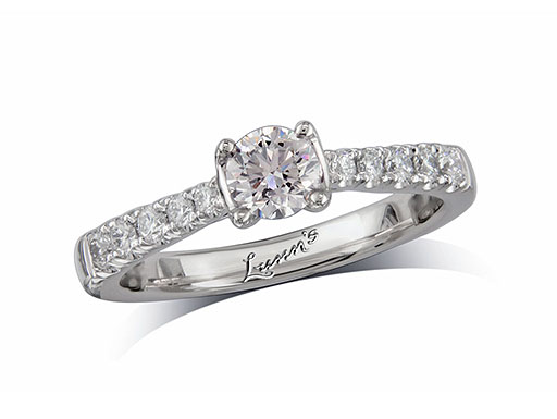 Platinum set single stone diamond engagement ring, with a certificated brilliant cut centre in a four claw setting, and diamond set shoulders. Perfect fit with a wedding ring. Total diamond weight: 0.66ct.