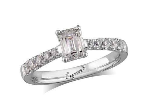 Platinum single stone diamond engagement ring, with a certificated emerald cut centre in a four claw setting, and diamond set shoulders. Perfect fit with a wedding ring. Total diamond weight: 0.75ct.