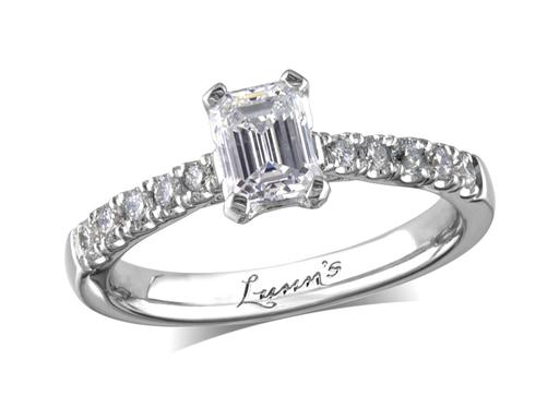 Platinum single stone diamond engagement ring, with a certificated emerald cut centre in a four claw setting, and diamond set shoulders. Perfect fit with a wedding ring. Total diamond weight: 1.16ct.