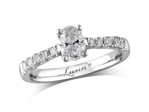 Platinum single stone diamond engagement ring, with a certificated oval cut centre in a four claw setting, and diamond set shoulders. Perfect fit with a wedding ring. Total diamond weight: 0.72ct.