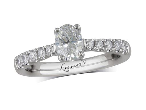 Platinum single stone diamond engagement ring, with a certificated oval cut centre in a four claw setting, and diamond set shoulders. Perfect fit with a wedding ring. Total diamond weight: 0.86ct.