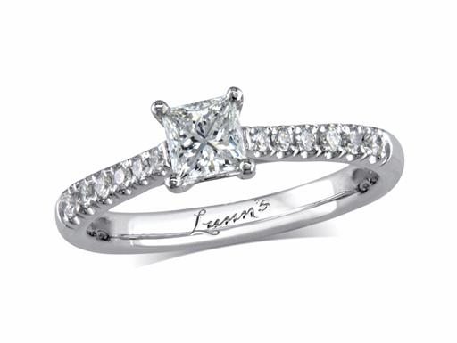 Platinum set single stone diamond engagement ring, with a certificated princess cut centre in a four claw setting, and diamond set shoulders. Perfect fit with a wedding ring. Total diamond weight: 0.58ct.