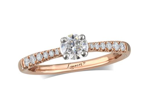 18 carat rose gold set single stone diamond engagement ring, with a certificated brilliant cut centre in a four claw setting, and diamond set shoulders. Perfect fit with a wedding ring. Total diamond weight: 0.46ct.