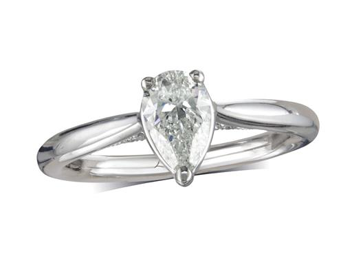 Platinum three claw single stone diamond engagement ring, with a certificated pear cut, featuring artistic diamond detail on the bridge of the setting. Perfect fit with a wedding ring.