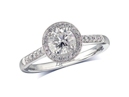 Platinum set diamond cluster engagement ring, with a certificated brilliant cut centre in a four claw setting, with a surrounding diamond set bezel and diamond set shoulders. Perfect fit with a wedding ring. Total cluster diamond weight: 0.96ct.