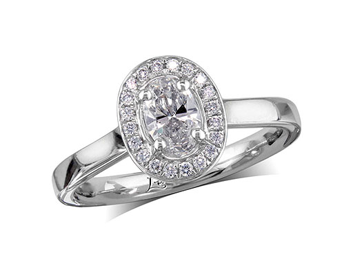 Platinum set diamond cluster engagement ring, with a certificated oval cut centre in a four claw setting, with a surrounding diamond set bezel. Perfect fit with a wedding ring. Total cluster diamond weight: 0.51ct.