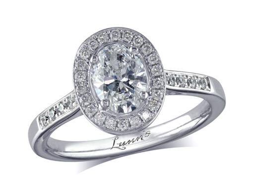 Platinum set diamond cluster engagement ring, with a certificated oval cut centre in a four claw setting, with a surrounding diamond set bezel and diamond set shoulders. Perfect fit with a wedding ring. Total cluster diamond weight: 0.95ct.