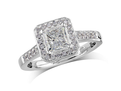 Platinum set diamond cluster engagement ring, with a certificated princess cut centre in a four claw setting, with a surrounding diamond set bezel and diamond set shoulders. Perfect fit with a wedding ring. Total cluster diamond weight: