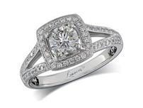 Platinum set diamond engagement ring, with a certificated brilliant cut in a four claw setting, surrounded by a diamond set cluster and split shoulders. Perfect fit with a wedding ring. Total diamond weight: 1.03ct.