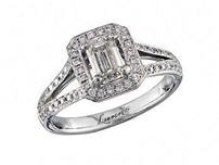 Platinum set diamond engagement ring, with a certificated emreald cut in a four claw setting, surrounded by a diamond set cluster and split shoulders. Perfect fit with a wedding ring. Total diamond weight: 1.01ct.