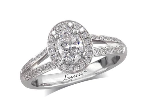 Platinum set diamond engagement ring, with a certificated oval cut in a four claw setting, surrounded by a diamond set cluster and split shoulders. Perfect fit with a wedding ring. Total diamond weight: 0.73ct.