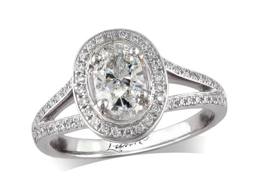 Platinum set diamond engagement ring, with a certificated oval cut in a four claw setting, surrounded by a diamond set cluster and split shoulders. Perfect fit with a wedding ring. Total diamond weight: 1.00ct.