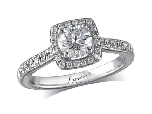 Platinum set diamond cluster engagement ring, with a certificated brilliant cut centre in a four claw setting, with a surrounding diamond set bezel and diamond set shoulders. Perfect fit with a wedding ring. Total cluster diamond weight: 0.97ct.