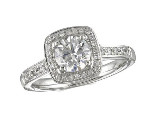 Platinum set diamond engagement ring, with a certificated brilliant cut centre in a four claw setting, surrounded by a diamond set cluster and shoulders. Perfect fit with a wedding ring. Total diamond weight: 1.27ct.