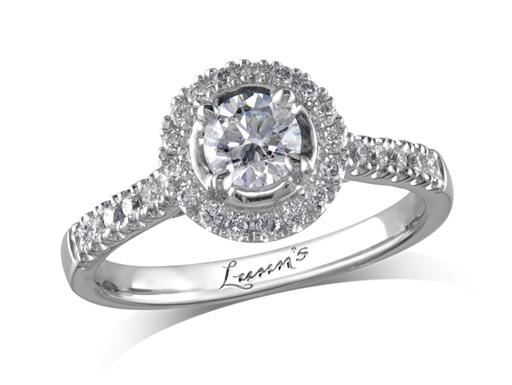 Platinum set diamond cluster engagement ring, with a certificated brilliant cut centre in a four claw setting, with a surrounding diamond set bezel and diamond set shoulders. Perfect fit with a wedding ring. Total cluster diamond weight: 0.58ct.