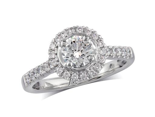 Platinum set diamond cluster engagement ring, with a certificated brilliant cut centre in a four claw setting, with a surrounding diamond set bezel and diamond set shoulders. Perfect fit with a wedding ring. Total cluster diamond weight: 0.78ct.