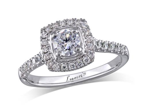 Platinum set diamond cluster engagement ring, with a certificated brilliant cut centre in a four claw setting, with a surrounding diamond set bezel and diamond set shoulders. Perfect fit with a wedding ring. Total cluster diamond weight: 0.69ct.
