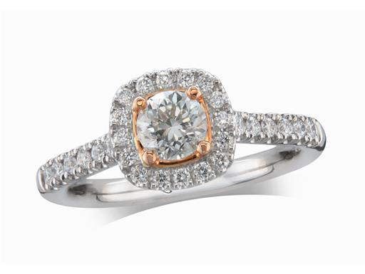Platinum set diamond cluster engagement ring, with a certificated brilliant cut centre in a four claw rose gold setting, with a surrounding diamond set bezel and diamond set shoulders. Perfect fit with a wedding ring. Total cluster diamond weight: 0.81ct.