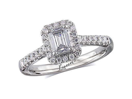 Platinum cluster diamond engagement ring, with a certificated emerald cut centre in a four claw setting, with a surrounding diamond set bezel and diamond set shoulders. Perfect fit with a wedding ring. Total cluster diamond weight: 0.83ct.