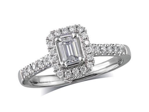 Platinum set diamond cluster engagement ring, with a certificated emerald cut centre in a four claw setting, with a surrounding diamond set bezel and diamond set shoulders. Perfect fit with a wedding ring. Total cluster diamond weight: 0.46ct.