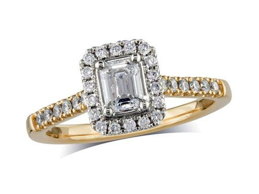 18 carat yellow gold cluster diamond engagement ring, with a certificated emerald cut centre in a four claw setting, with a surrounding diamond set bezel and diamond set shoulders. Perfect fit with a wedding ring. Total cluster diamond weight: 0.79ct.