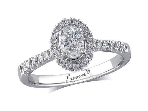 Platinum set diamond cluster engagement ring, with a certificated oval cut centre in a four claw setting, with a surrounding diamond set bezel and diamond set shoulders. Perfect fit with a wedding ring. Total cluster diamond weight: 0.56ct.