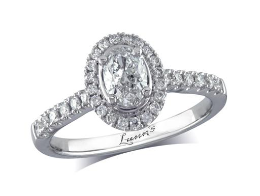 Platinum set diamond cluster engagement ring, with a certificated oval cut centre in a four claw setting, with a surrounding diamond set bezel and diamond set shoulders. Perfect fit with a wedding ring. Total cluster diamond weight: 0.71ct.