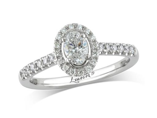 Platinum cluster diamond engagement ring, with a certificated oval cut centre in a four claw setting, with a surrounding diamond set bezel and diamond set shoulders. Perfect fit with a wedding ring. Total cluster diamond weight: 0.59ct.