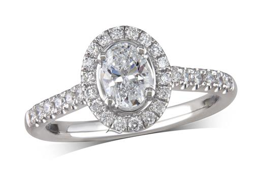 Platinum cluster diamond engagement ring, with a certificated oval cut centre in a four claw setting, with a surrounding diamond set bezel and diamond set shoulders. Perfect fit with a wedding ring. Total cluster diamond weight: 0.84ct.
