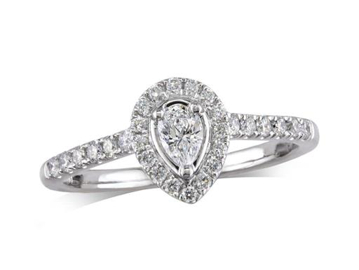 Platinum cluster diamond engagement ring, with a certificated pear cut centre in a three claw setting, with a surrounding diamond set bezel and diamond set shoulders. Perfect fit with a wedding ring. Total cluster diamond weight: 0.26ct