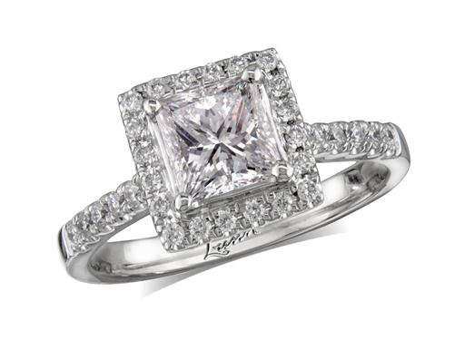 Platinum diamond cluster engagement ring, with a certificated princess cut centre in a four claw setting, with a surrounding diamond set bezel and diamond set shoulders. Perfect fit with a wedding ring. Total cluster diamond weight: 1.32ct.