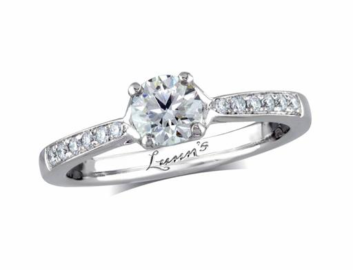 Platinum single stone diamond engagement ring, with a certificated brilliant cut centre in a four claw setting, and diamond set shoulders. Perfect fit with a wedding ring. Total diamond weight: 0.67ct.