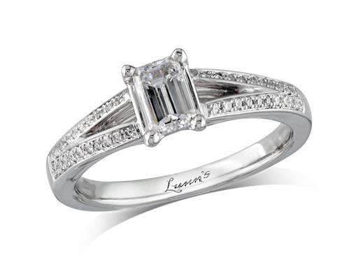 Platinum set single stone diamond engagement ring, with a certificated emerald cut centre in a four claw setting, and diamond set split shoulders. Perfect fit with a wedding ring. Total diamond weight: 0.63ct.