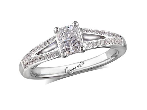Platinum set single stone diamond engagement ring, with a certificated radiant cut centre in a four claw setting, and diamond set shoulders. Perfect fit with a wedding ring. Total diamond weight: 0.64ct.
