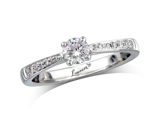 Platinum set single stone diamond engagement ring, with a certificated brilliant cut centre in a four claw setting, and diamond set shoulders. Perfect fit with a wedding ring. Total diamond weight: 0.40ct centre.