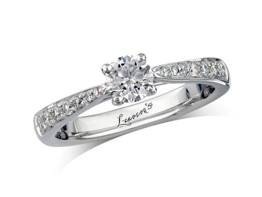 Platinum set single stone diamond engagement ring, with a certificated brilliant cut centre in a four claw setting, and diamond set shoulders. Perfect fit with a wedding ring. Total diamond weight: 0.60ct.