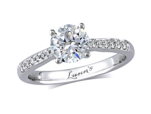 Platinum set single stone diamond engagement ring, with a certificated brilliant cut centre in a four claw setting, and diamond set shoulders. Perfect fit with a wedding ring. Total diamond weight: 1.33ct.