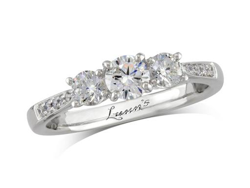 Platinum set three stone diamond engagement ring, with a certificated brilliant cut centre in a four claw setting, and one brilliant cut on each side with diamond set shoulders. Perfect fit with a wedding ring. Total diamond weight: 0.67ct.