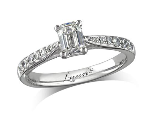 Platinum set single stone diamond engagement ring, with a certificated emerald cut centre in a four claw setting, and diamond set shoulders. Perfect fit with a wedding ring. Total diamond weight: 0.70ct.